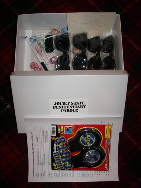 Parole box and contents, including sunglasses and handcuffs