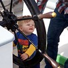 Newburyport: Schooner Adventure: Young boy at wheel of 90-year-old ship