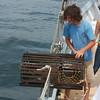 Schooner Ardelle: Opening lobster trap