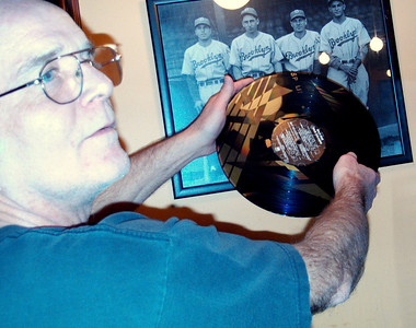 Jeff tries to catch the light just right on the etched Split Enz LP.