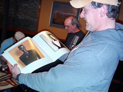 Doug, our waiter at The Breckenridge looks through a Roger Dean Album Cover Album book.