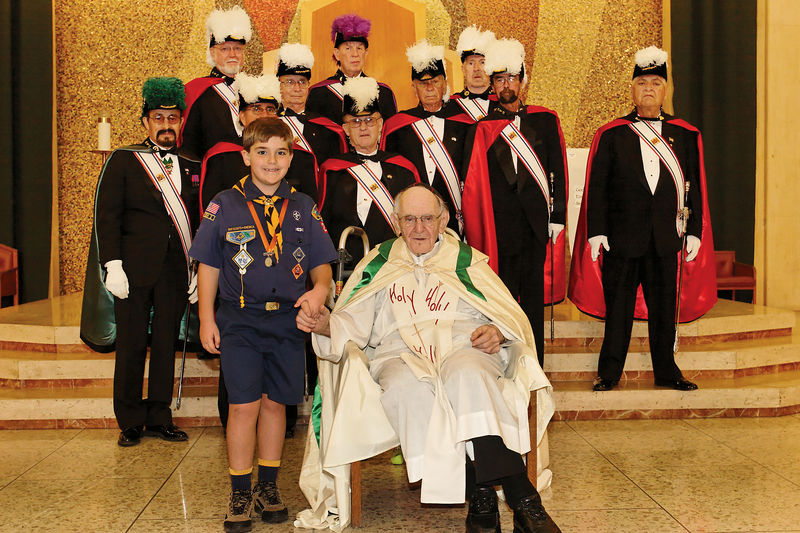 Nathan with Monsignor Sammon and the Knights of Columbus