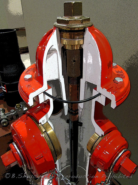 Sorry, should have updated the caption sooner!  It is the inside of a fire hydrant - the company I work for makes them, and we have this one on display in the lobby area - I've been meaning to take a picture of it forever and finally got the chance.