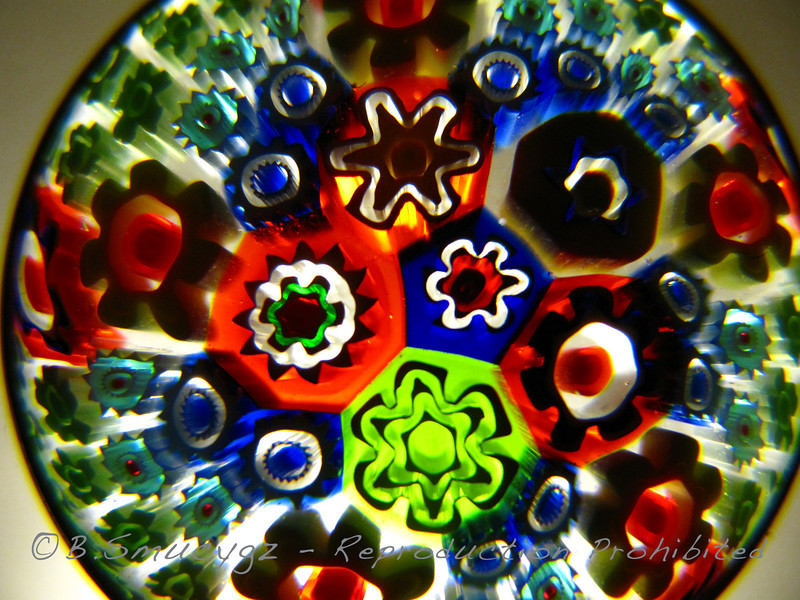 Pendant from a necklace (not glass, maybe resin?) - I laid it directly on the lens of my point-and-shoot and shot upward toward the light, supermacro mode...