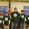 They were each given a coveted Elkins Fish and Game Club tee shirt.