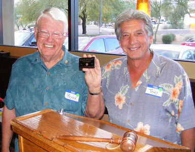 Tony Finocchio presented Roger with a Past President's name badge, a program which Tony initiated years ago.