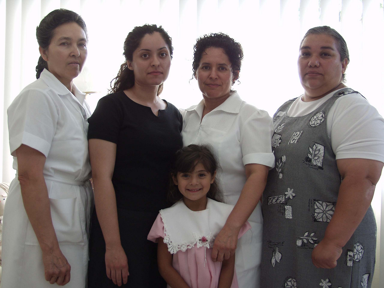 <h1>After My Grandmother's Funeral, June 2002</h1> <h3> Three of these women kept house for my grandmother, Rose Kadesky, on alternate days (and took care of her; she was 100 years old when she died.)  The young woman in black is a nurse and the daughter of the woman on her left.  She happened to have been assigned to my grandmother's ward the last time Rose was in the hospital. <h3>