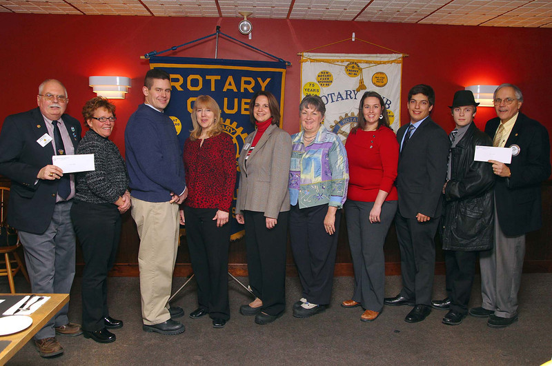The Fitchburg and Leominster Rotary Clubs gave out checks to the Fitchburg and Leominster school music programs to help support the arts on Tuesday during their joint meeting at Cornerstone Restaurant on Central Street Leominster. From left is Co-Chair of the Leominster Rotary John Tata, Karen DiNardo LH Band Booster, South East Elementary School music teacher Larry Zuaro, library and medai Specialist and director of the Fall Brook Elementary School Song Birds  Deborah Caudill, President Leominster Rotary Mary Dean, President Fitchburg Rotary Sharon Bernard, FHS Band Director Tab itha Greenlees, LHS drum major Kyle Davi, FHS drum major Thomas Carvin and committee member of the Fitchburg Rotary David Moquin. Missing from photo Paul Gauvin of the Fitchburg Rotary, LHS band director Barry Hudson and FHS drum major Evan Morley. SENTINEL & ENTERPRISE/JOHN LOVE