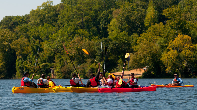 paddles raised in celebration. the comets won the beep ball game on friday and had a great time on the water saturday .
