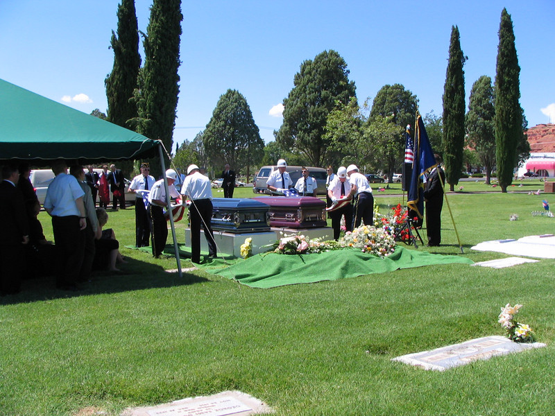 Folding the Flags at a double burial, a man and his wife, both vererans