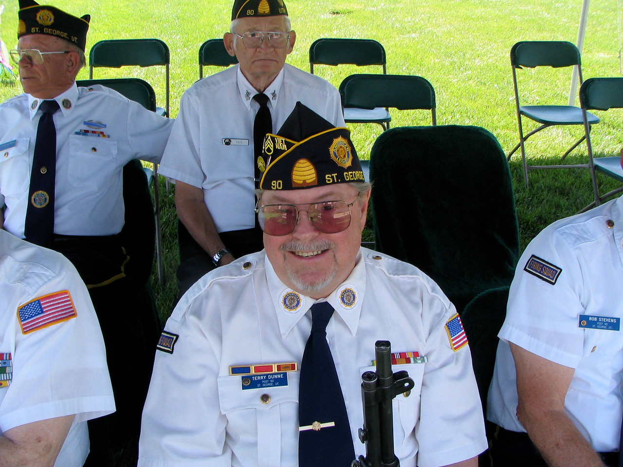 Back:  Lloyd Beardsley and Leland Tate, Honor Guard. Front Center:  Terry Dunne, Shooter.