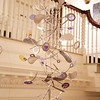 Art Opening: Kinetic sculpture hanging inside stairs