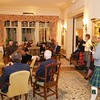 Burns Night: Group in Music Room listening to Lewis Raymond playing and Thomas Ouellette singing