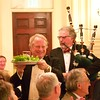 Burns Night: Ken Smith with can of haggis and Sir Jeremy Bell playing bagpipes in Dining Room