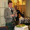 Burns Night: George Gilpatrick addressing the haggis, in doorway to Conservatory, with Gerard behind