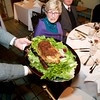 Burns Night: George Gilpatrick showing real haggis to Sigrid Lindo in Conservatory