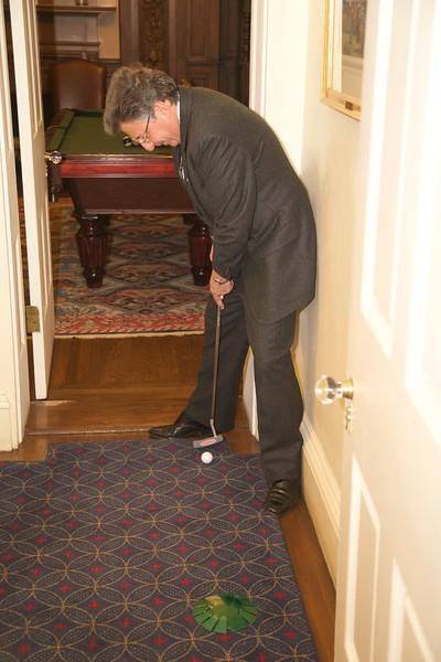 Burns Night: Ken Turino completing Hole 2 in second floor coatroom