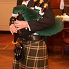 Burns Night: Sir Jeremy Bell playing bagpipes in lobby
