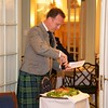 Burns Night: George Gilpatrick cutting the haggis, in doorway to Conservatory