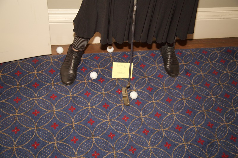 Burns Night: All of foursome's balls outside elevator on Hole 1 on second floor