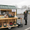 Growing Places, located at the Doyle Center in Leominster, had their Montachusett Mobile Market in the parking lot of the Leominster Veterans Center and Senior Center on Wednesday, March 25, 2020. They built this mobile market, they nicknamed The Veggie Wagon, last year and are now using it during this emergency to help bring fresh produce to anyone that needs it. They United Way helped them by donating their instant meals they make to give out, for free, at the mobile market. Waiting to ring in customers is Sami Dokus the youth development and sustainability coordinator for Growning Places. SENTINEL & ENTERPRISE/JOHN LOVE