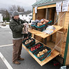 Growing Places, located at the Doyle Center in Leominster, had their Montachusett Mobile Market in the parking lot of the Leominster Veterans Center and Senior Center on Wednesday, March 25, 2020. They built this mobile market, they nicknamed The Veggie Wagon, last year and are now using it during this emergency to help bring fresh produce to anyone that needs it. They United Way helped them by donating their instant meals they make to give out, for free, at the mobile market. Volunteer Chamb Meehan gets some produce for Donna Chace and her granddaughter Shadiya Schofield, 6, both trying to practice social distancing. SENTINEL & ENTERPRISE/JOHN LOVE