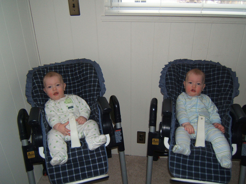 Sitting in their high chairs waiting for breakfast