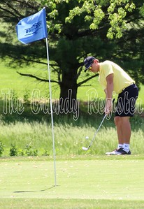 Grundy Center's Tanner Appel chips onto the No. 6 green at Westwood Golf Course in Newton for the first round of the 1A state golf tournament on Thursday.