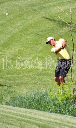 Grundy Center's Matthew Sternhagen chips out of a valley just off the fairway on No. 2 at Westwood Golf Course in Newton during Thursday's first round of the 1A state meet.