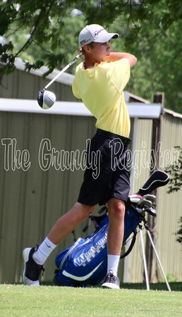 Grundy Center's Andy Cox tees off at Westwood Golf Course in Newton for the first round of the 1A state golf tournament on Thursday.