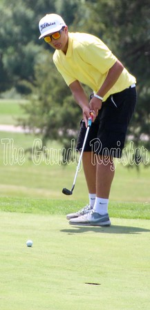 Grundy Center's Travis Kuester keeps his eye on the ball at Westwood Golf Course in Newton for the first round of the 1A state golf tournament on Thursday.