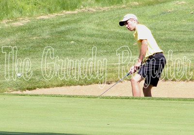 Grundy Center's Andy Cox chips onto the green at Westwood Golf Course in Newton for the first round of the Class 1A state golf tournament on Thursday.