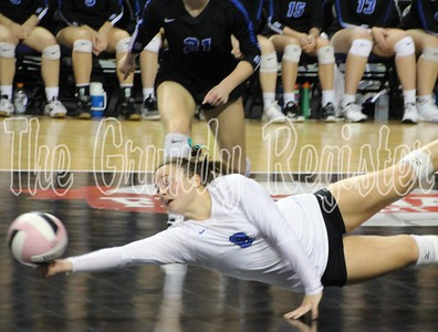 Dike-New Hartford's Sydney Petersen leaps to the floor to save a ball during Friday's 2A championship game against Western Christian. (Jake Ryder/Mid-America Publishing photo)