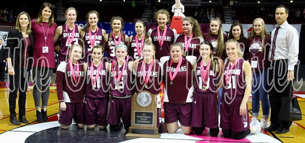 The Grundy Center girls basketball team with its runner-up trophy in Class 2A after Saturday night's loss to Cascade. (Jake Ryder/The Grundy Register)