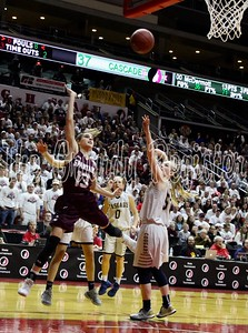 Grundy Center's Hailey Wallis (13) lifts a shot attempt during the second half of the 2A championship game with Cascade in Des Moines on Saturday night. (Jake Ryder/The Grundy Register)