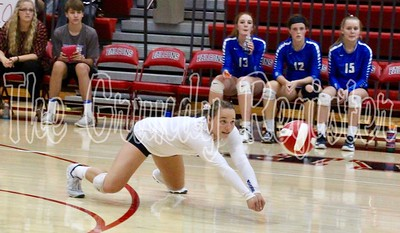 Dike-New Hartford's Sydney Petersen dives to get her hands under a ball during Thursday's volleyball match with Hudson in Parkersburg. (Jake Ryder/Eclipse News-Review photo)