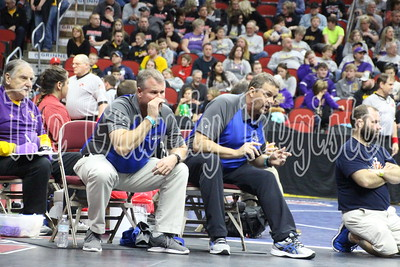 SH-BCLUW head coaches Stacy Simpson and Mike Olson give advice to Taylor Kolthoff during his 113-pound first-round consolation match at the 2A state wrestling meet in Des Moines on Thursday. (Jake Ryder/Mid-America Publishing)