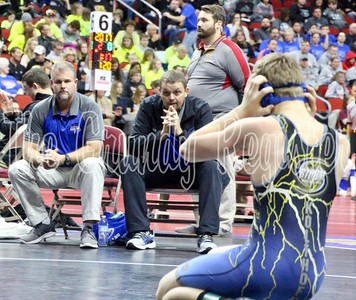 SH-BCLUW's Taylor Kolthoff looks to his corner for advice from Storm coaches Stacy Simpson (left) and Mike Olson. (Jake Ryder/Mid-America Publishing)