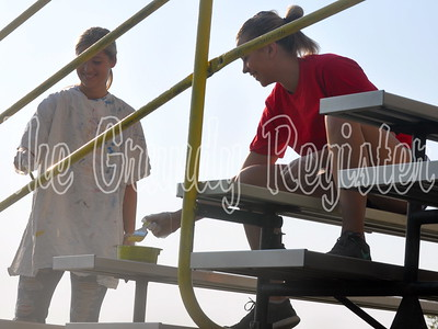 Vanessa Drummer (left) and Easton Swanson (right) paint during the school improvement day.