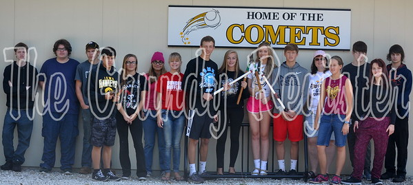 A group of students cleaned up the area around the softball field as part of the school improvement day Wednesday.