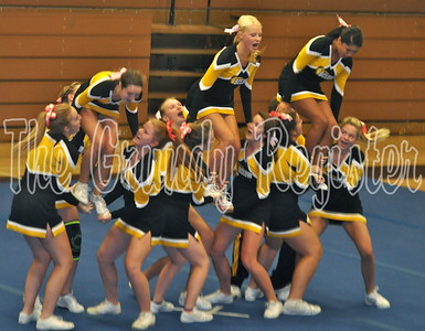 The Comet cheerleaders performed a routine during the coronation ceremony in the high school gym.