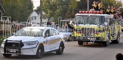 With an escort from a Grundy County Sheriff's Deputy, BCLUW cheerleaders lead the homecoming parade on Thursday evening.