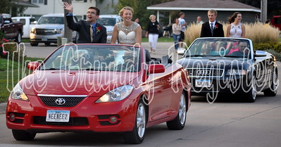King and queen candidates Drew Carson, Lauren Anderson, Brad Barkema and Madison Trinkle ride in the parade.