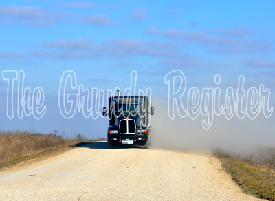 A Hook Farms truck pulls off of a gravel road between Holland and Wellsburg.