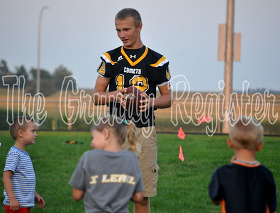 BCLUW senior quarterback Brad Barkema chats it up with future Comet stars during the punt, pass and kick competition at Friday night's event.