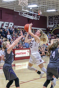 Grundy Center's Brooke Flater (center) takes it to the basket during Friday's game with AGWSR. (Jake Ryder photo)