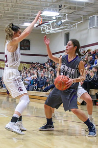 AGWSR's Aubrie Fisher is trapped in the backcourt by Grundy Center's Hailey Wallis and Cora Saak during Friday's game in Grundy Center. (Jake Ryder/Mid-America Publishing)