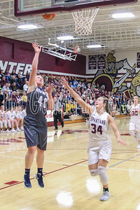 AGWSR's MaKenna Kuper runs in the lay-up as Grundy Center's Kylie Willis rushes in to defend during Friday's game. (Jake Ryder/Mid-America Publishing)