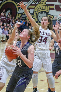 AGWSR's Alyssa Hames looks for an opening to put up the shot in the paint during Friday's game with Grundy Center. (Jake Ryder photo)