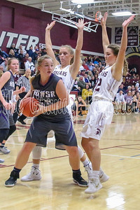 AGWSR's Whitanie Nederhoff looks for an outlet after grabbing the defensive rebound in Friday's game with Grundy Center. (Jake Ryder/Mid-America Publishing)